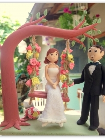Figurina pentru tort - Mire si mireasa in leagan