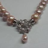 Sirag perle roz cu inchizatoare din aur alb